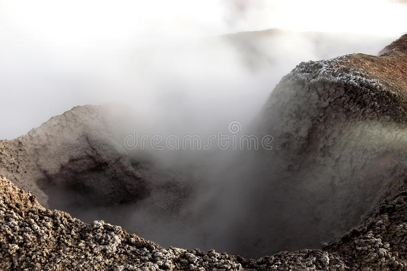 The Sol de la Manana, Rising Sun steaming geyser field high up in a massive crater in Bolivian Altiplano, Bolivia. The Sol de la Manana, Rising Sun steaming stock photo