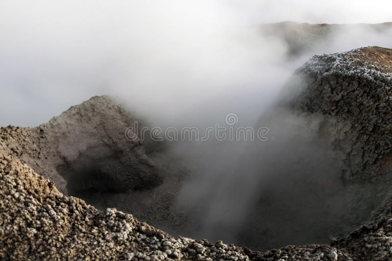 The Sol de la Manana, Rising Sun steaming geyser field high up in a massive crater in Bolivian Altiplano, Bolivia. The Sol de la Manana, Rising Sun steaming royalty free stock images