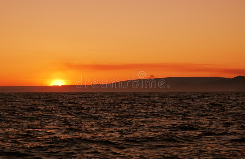 Sol en el océano fotos de archivo