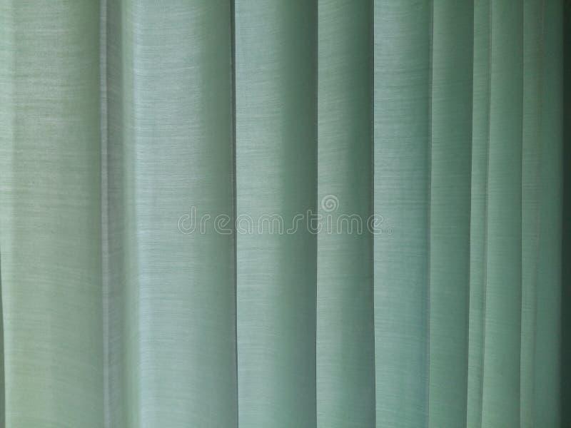 Sol en la mañana en las cortinas de la tela foto de archivo