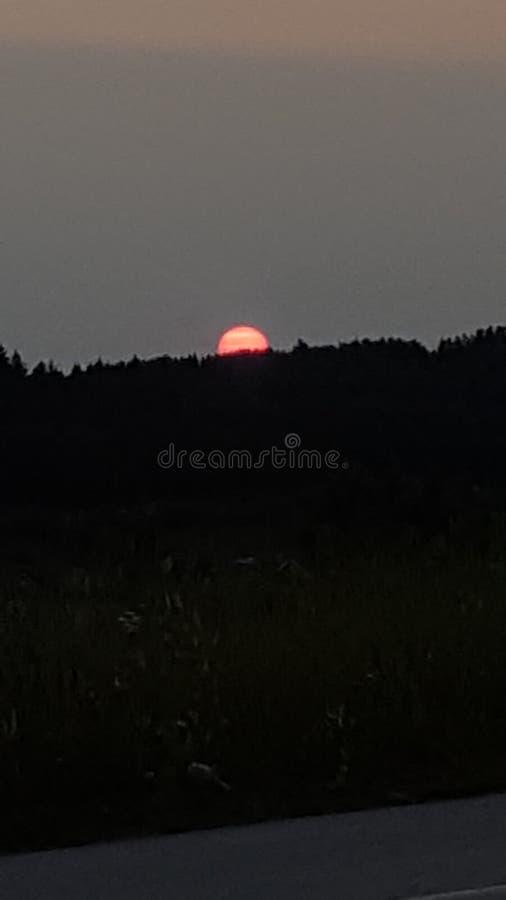Sol för solnedgångankringunedit arkivfoto