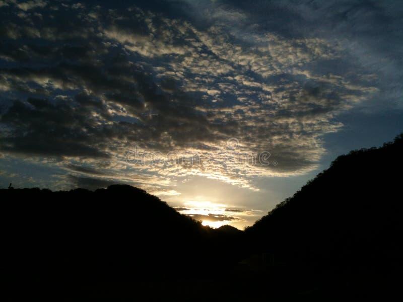 Sol nublada fotografía de archivo
