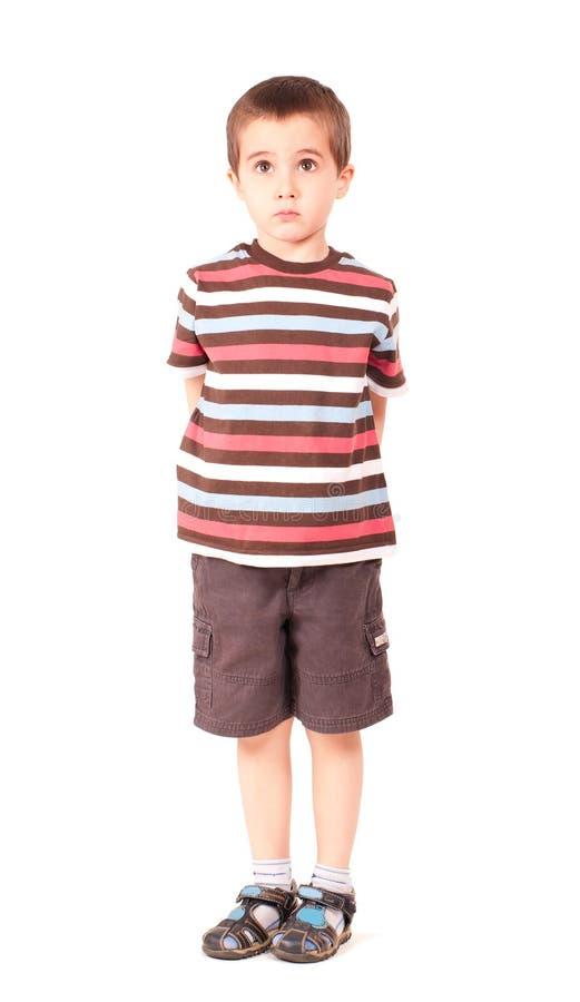 Sola mirada triste del niño pequeño fotografía de archivo libre de regalías