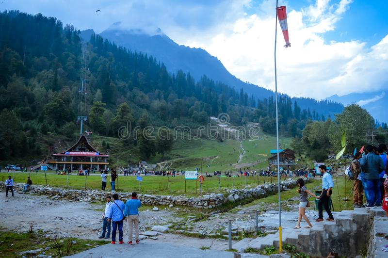 SOLANG VALLEY, MANALI, HIMACHAL PRADESH, India OCTOBER 26 2017: Tourists walking around on ski ground at Paragliding site. In summer famous for adventure royalty free stock photos