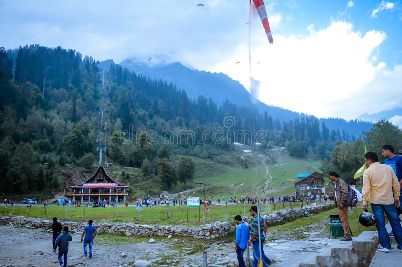 SOLANG VALLEY, MANALI, HIMACHAL PRADESH, India OCTOBER 26 2017: Tourists walking around on ski ground at Paragliding site. In summer famous for adventure stock images