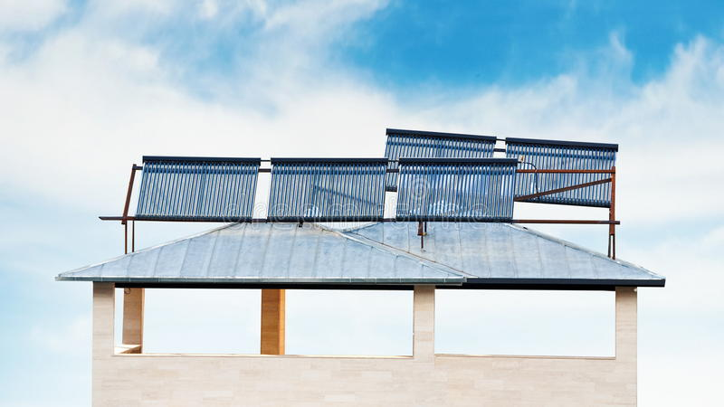 Solar batteries on the house. Roof royalty free stock images