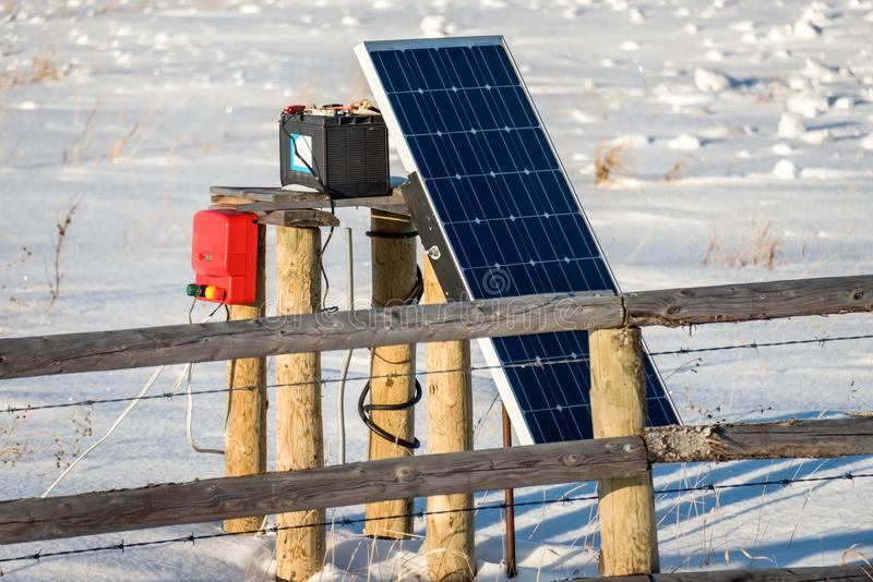 The solar battery charges the device for electric fencing stock images