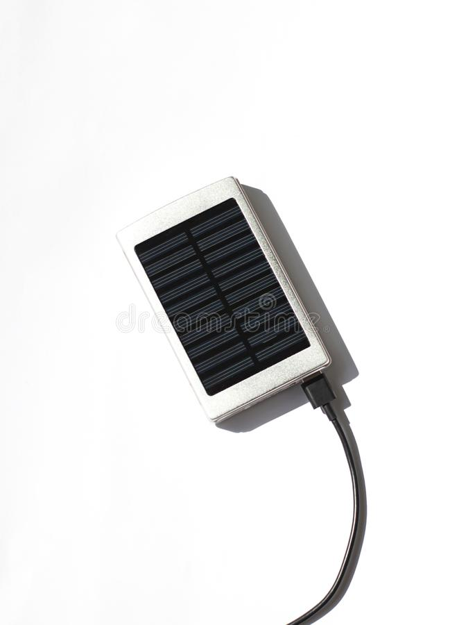 Solar battery panel charger connected to a device via an usb cable. stock photography