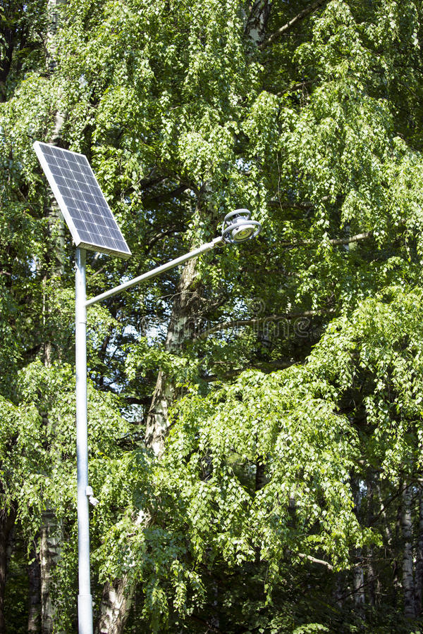 Solar battery. Powers an electric lamp in the park stock photography