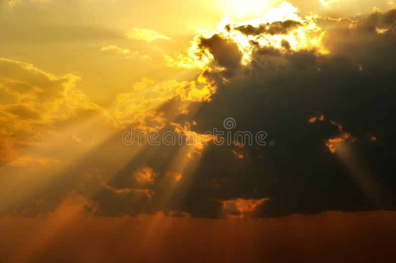 Solar beams. Magic solar beams coming out across clouds royalty free stock photo