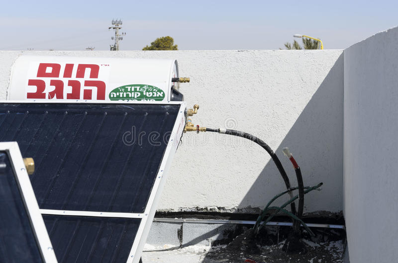 The solar boiler house roof- Mitzpe Ramon, Israel. Midle East - Mitzpe Ramon, Israel. February 29,The installation of new solar water heaters companies `Hom royalty free stock photo