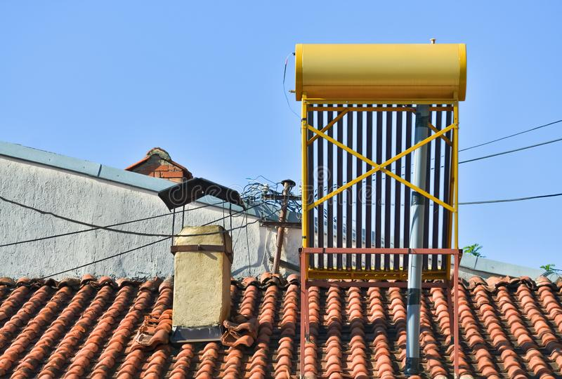 Solar boiler on the roof. Closeup of a solar boiler on the roof of a house in the village stock photography