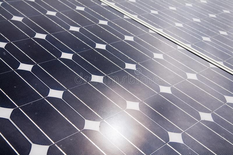 Solar cells. In the center of the sun, alternative, blue, building, clean, concept, eco, ecological, ecology, electric, electrical, electricity, energy stock image