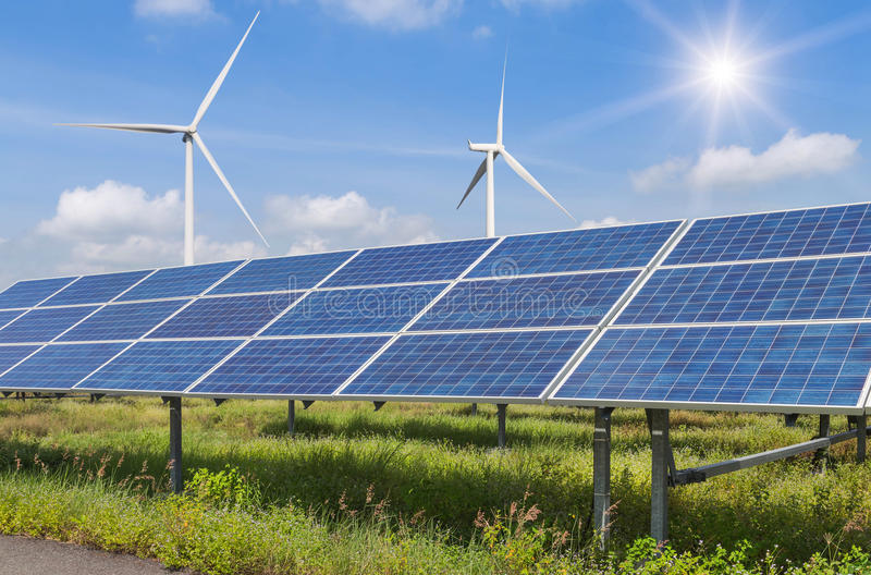 Solar cells and wind turbines generating electricity in power station alternative renewable energy stock image