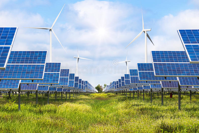 Solar cells and wind turbines generating electricity in power station alternative renewable energy royalty free stock photography