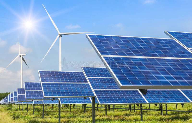 Solar cells and wind turbines generating electricity in power station alternative renewable energy stock photo