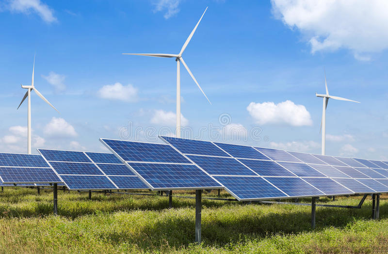 Solar cells and wind turbines in power station alternative renewable energy from nature royalty free stock photo