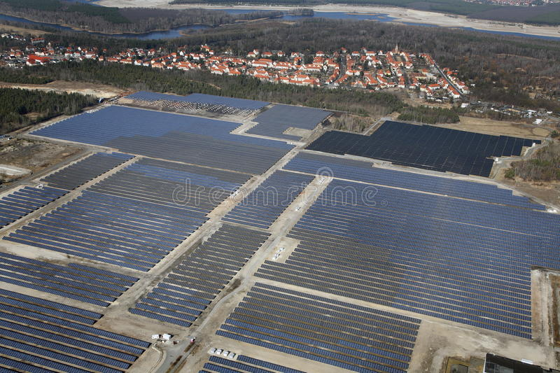 Solar collector field. A huge solar collector field next to a village in Germany stock photography