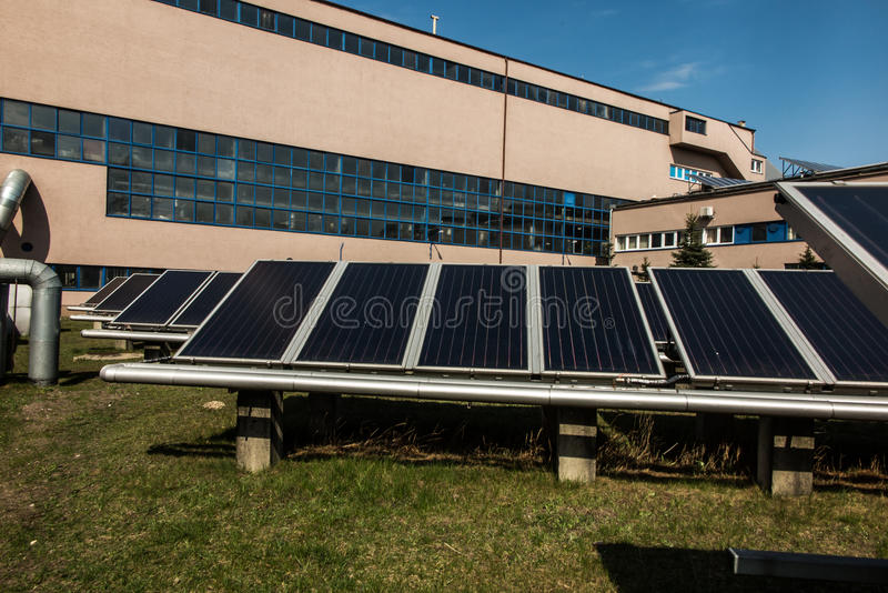 Solar collectors in the heat. Solar collectors supporting the work of heating stock photo