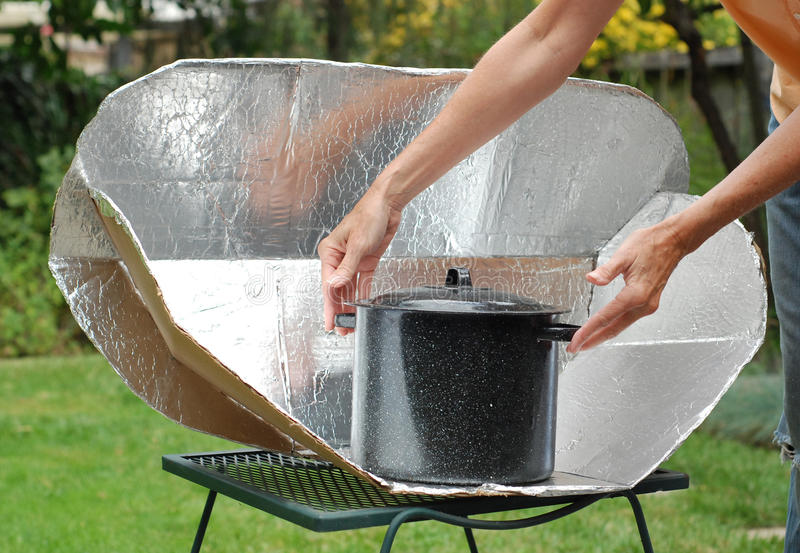 Solar Cooker. Solar Cooking Oven with black pot stock image