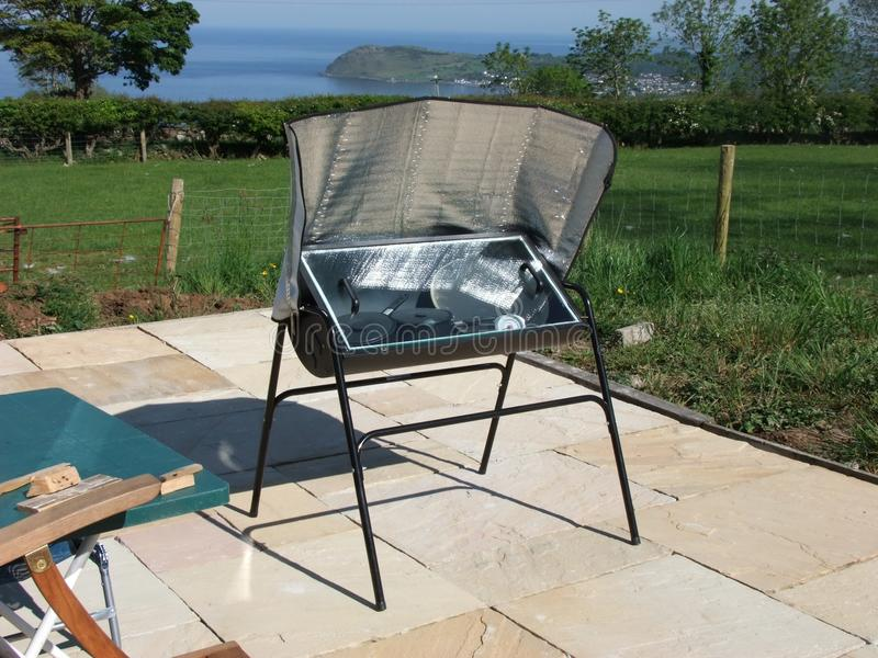 Solar oven. A solar cooker is a device which uses the energy of direct sunlight to heat, cook or pasteurise drink. Many solar cookers currently in use are stock photography