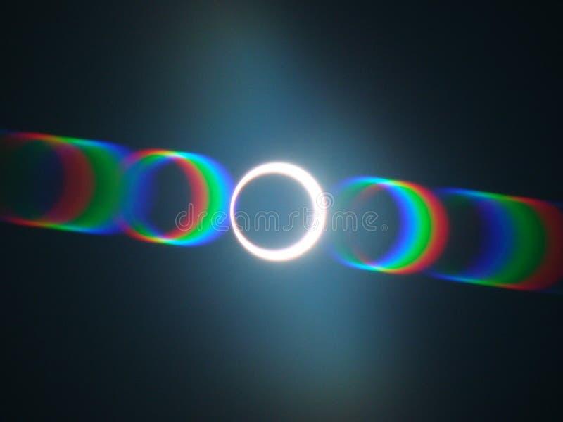 Solar eclipse seen through a film strip. Solar eclipse watched through a film strip royalty free stock image