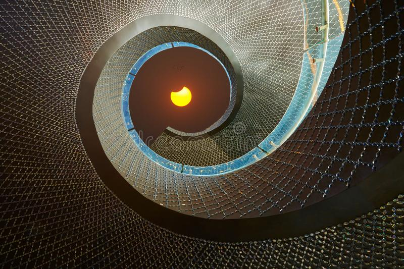 Solar eclipse seen from rotative stair royalty free stock photography