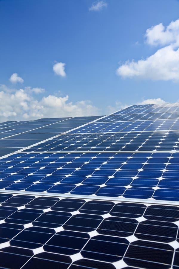 Solar Energy. Large solar panel against blue sky, power energy royalty free stock image