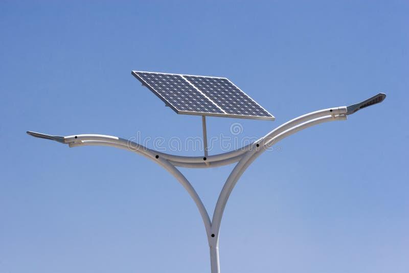 Solar energy. Street light with solar panel energy over blue sky royalty free stock photography