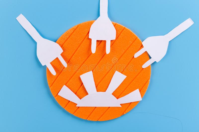 Solar energy concept. Sun and electrical plugs stock photo