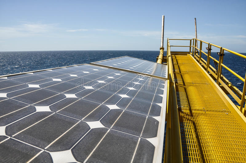 Solar energy with Flare station of oil and rig stock photos