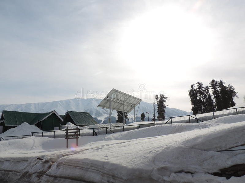 Solar energy generation in snow clad mountains stock photos