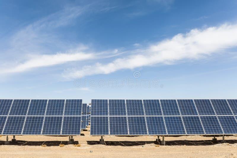 Solar energy on gobi desert. Solar panels in golmud city, new energy on the gobi desert against a blue sky royalty free stock image