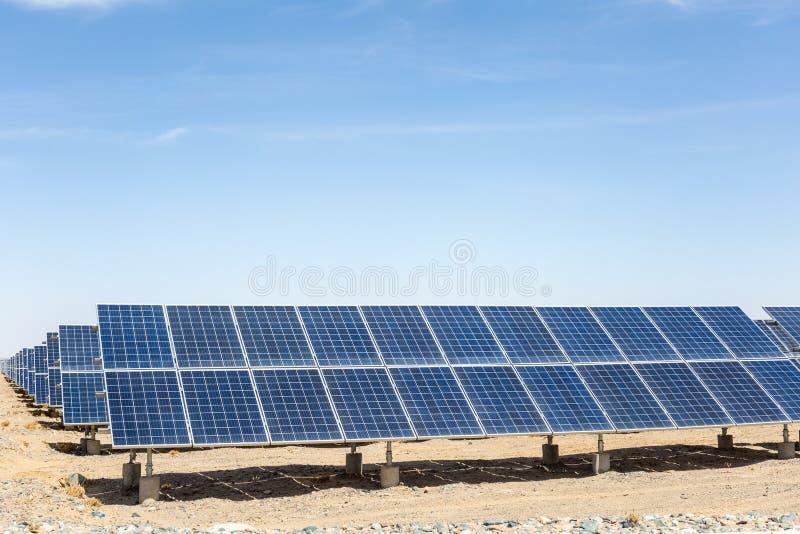 Solar energy on gobi desert. Solar panels on the gobi desert, new energy against a blue sky stock photography