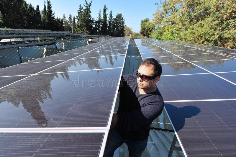 Solar Energy - Green Electricity. GADERA, ISR - JAN 28:Solar panels installed on a roof on Jan 28 2011.Israeli engineers are at the cutting edge of solar energy stock photo