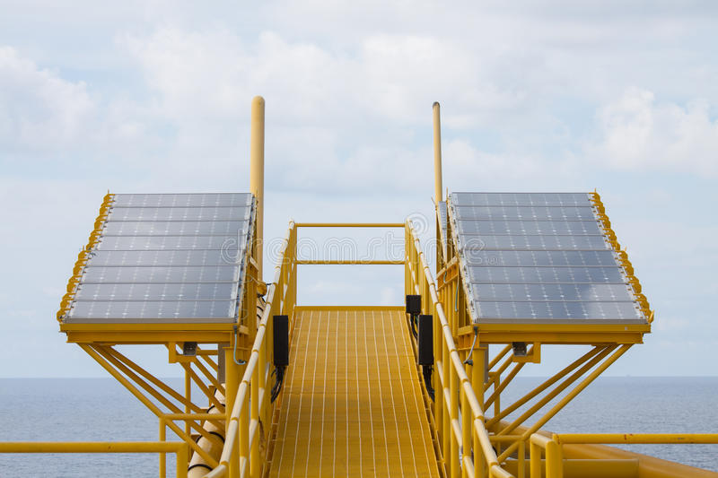 Solar energy is a green power, Solar cell for generate power for supply electrical equipment in offshore oil and gas platform.  royalty free stock images
