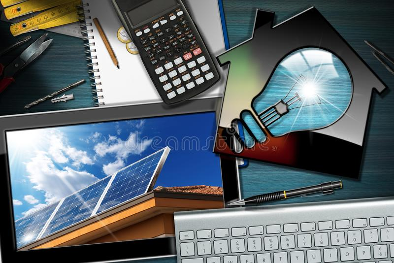 Solar Energy - Model House with Light Bulb. Solar Energy - Model house with a light bulb on a desk with a tablet computer with solar panel over a roof royalty free stock photography