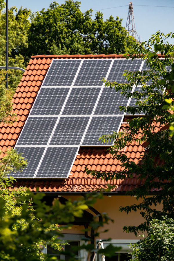 Solar energy panels mounted on a house roof. Installation of photovoltaic solar energy panels mounted on a house roof for converting solar energy to electricity royalty free stock photo