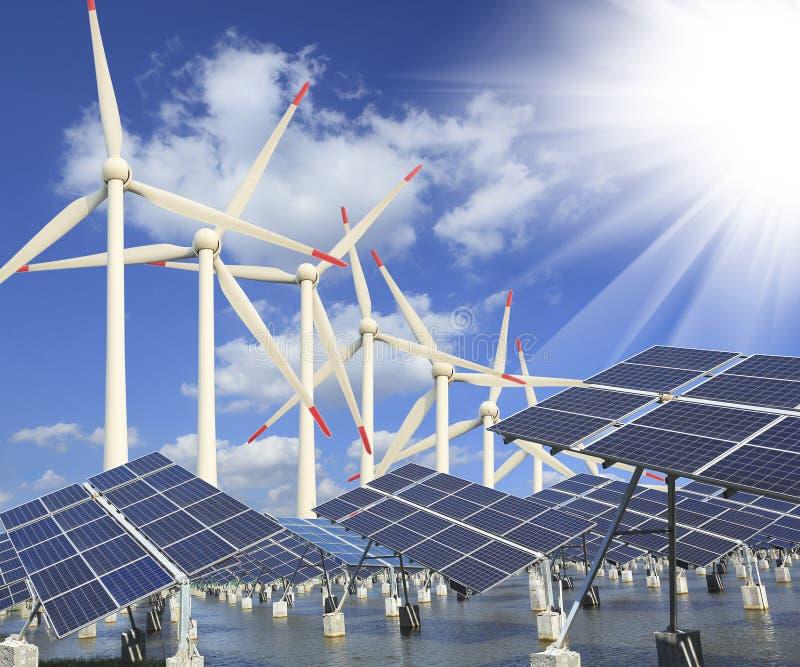 Solar energy panels and wind turbine. Power plant using renewable solar energy with sun and wind turbine stock photos