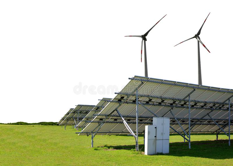 Solar energy panels with wind turbines in the meadow on white background. royalty free stock images