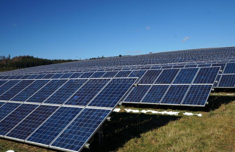Solar Energy Park. Solar energy through photovoltaic panels is harvested on this farm in Bavaria royalty free stock photos