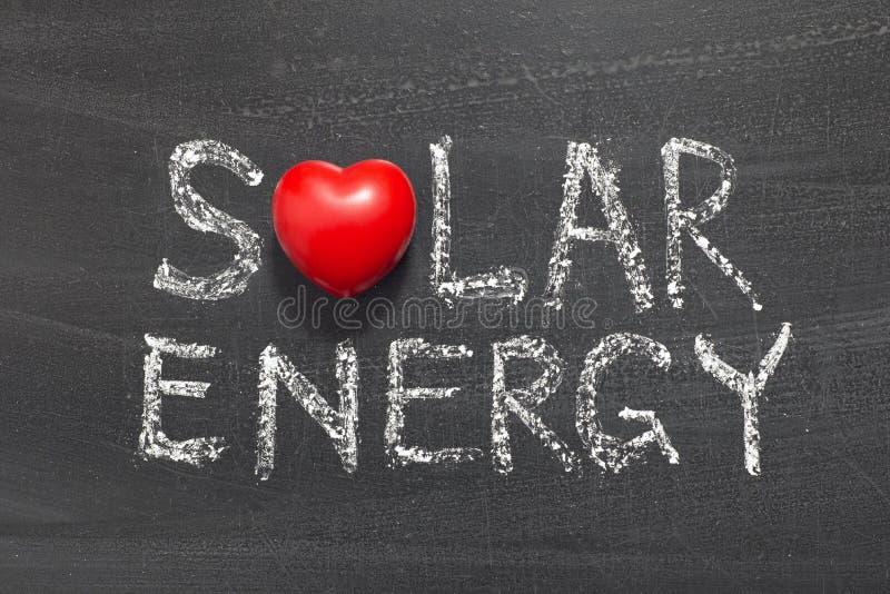 Solar energy. Phrase handwritten on school blackboard stock image
