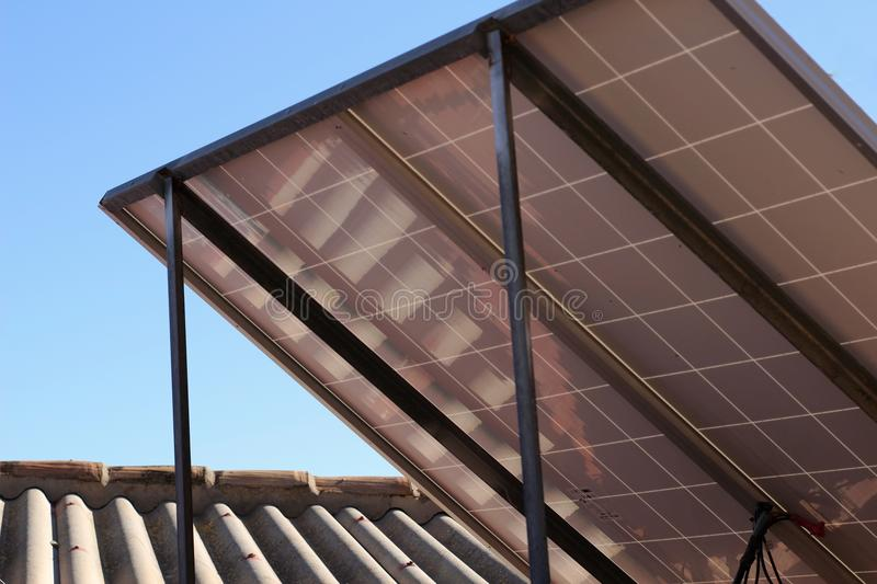 Solar energy plates on the roof. At home stock photo