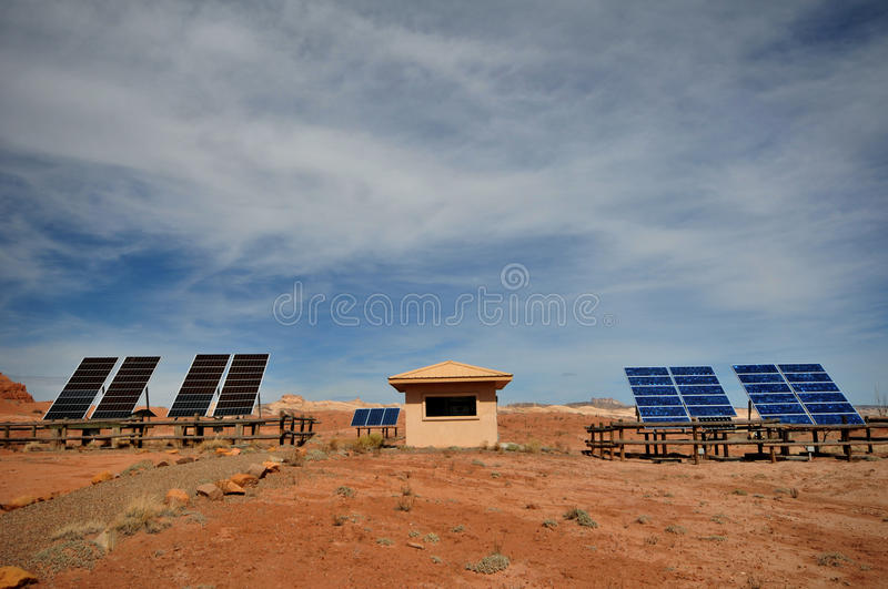 Solar energy from the sun. Full view of solar panels and building in desert royalty free stock images