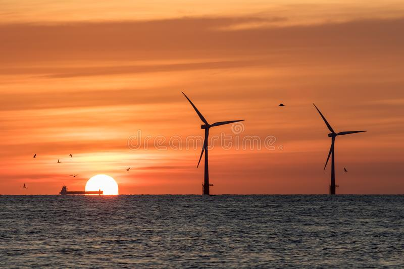 Solar energy and wind power representing climate change and global warming stock photo