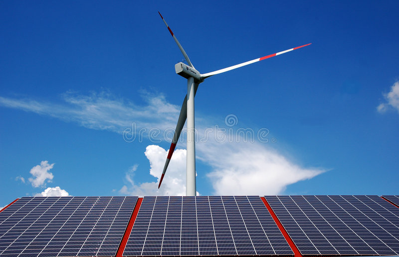 Solar energy and windmill stock image