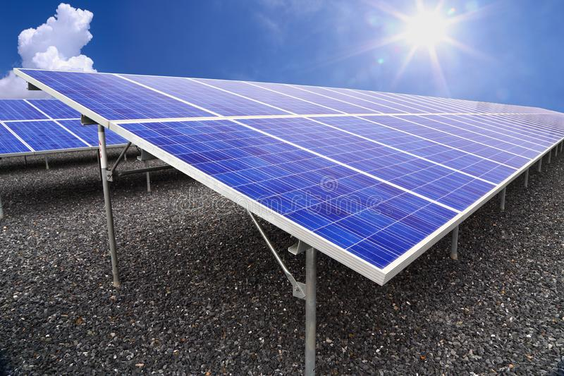 Solar farm eco photovoltaic power station on stone yard. A photovoltaic power station,is a photovoltaic system designed for the supply of merchant power into the royalty free stock photo