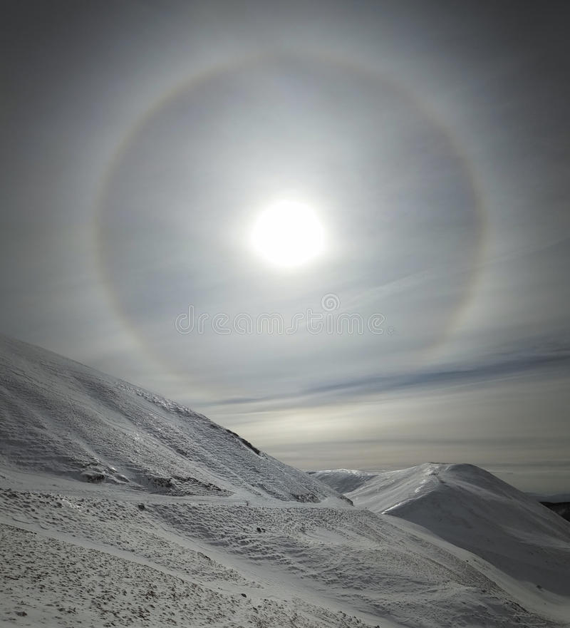 Solar halo in cloudy sky. royalty free stock photography