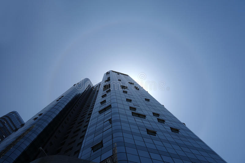 Solar halo with modern building stock photo