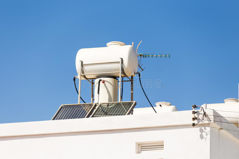 Solar heater for green energy. Contemporary hot water panels on a house stock image